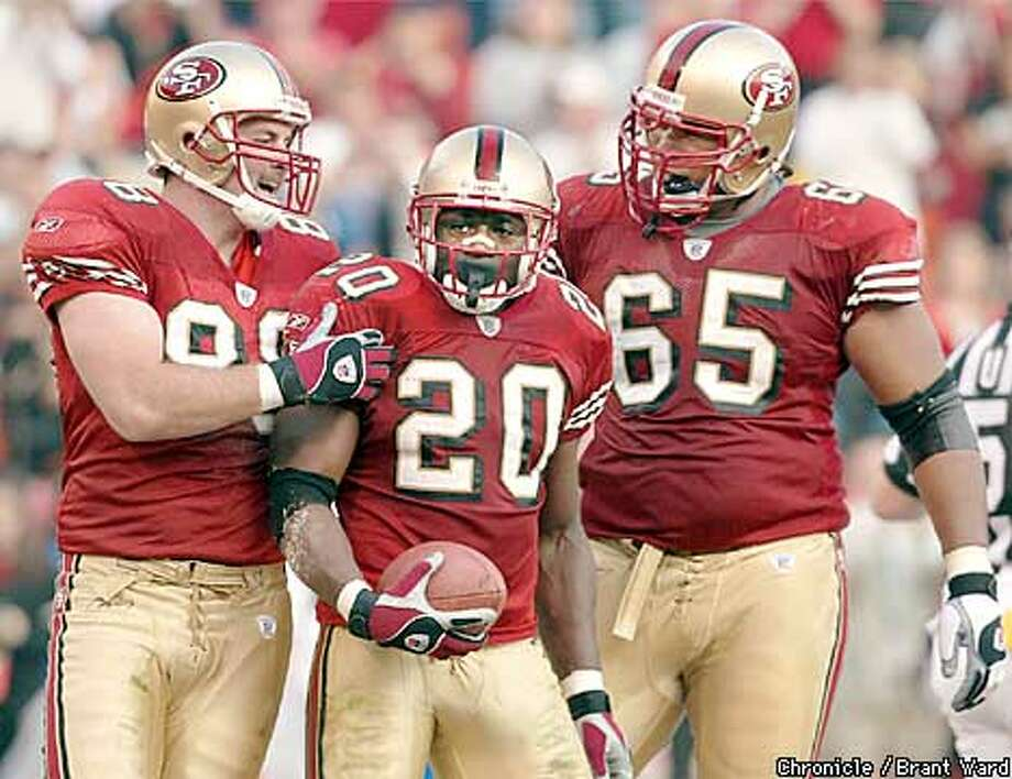 49ERS8-01DEC02-SP-BW--Garrison Hearst is welcomed by Justin Swift, left and Ron Stone after his third touchdown of the day. 49ers vs Seattle at Candlestick Park. By Brant Ward/Chronicle