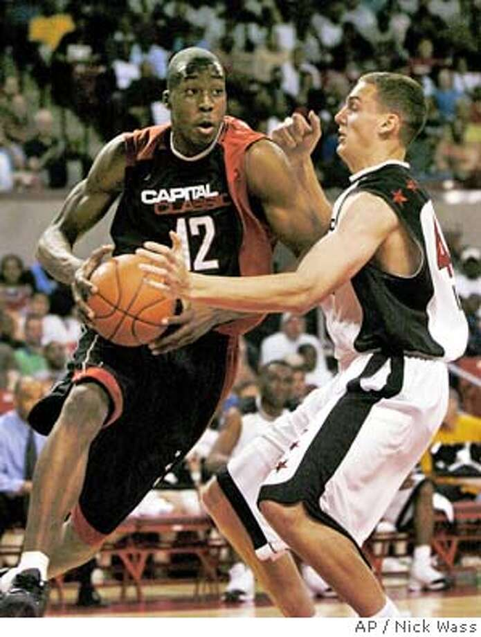 ** FOR USE WITH NBA DRAFT STORIES ** Dwight Howard (12) drives to the basket against Alexander Kaun in the first half of the Jordan Capital Classic in this April 17, 2004 file photo in College Park, Md. (AP Photo/Nick Wass) Photo: NICK WASS