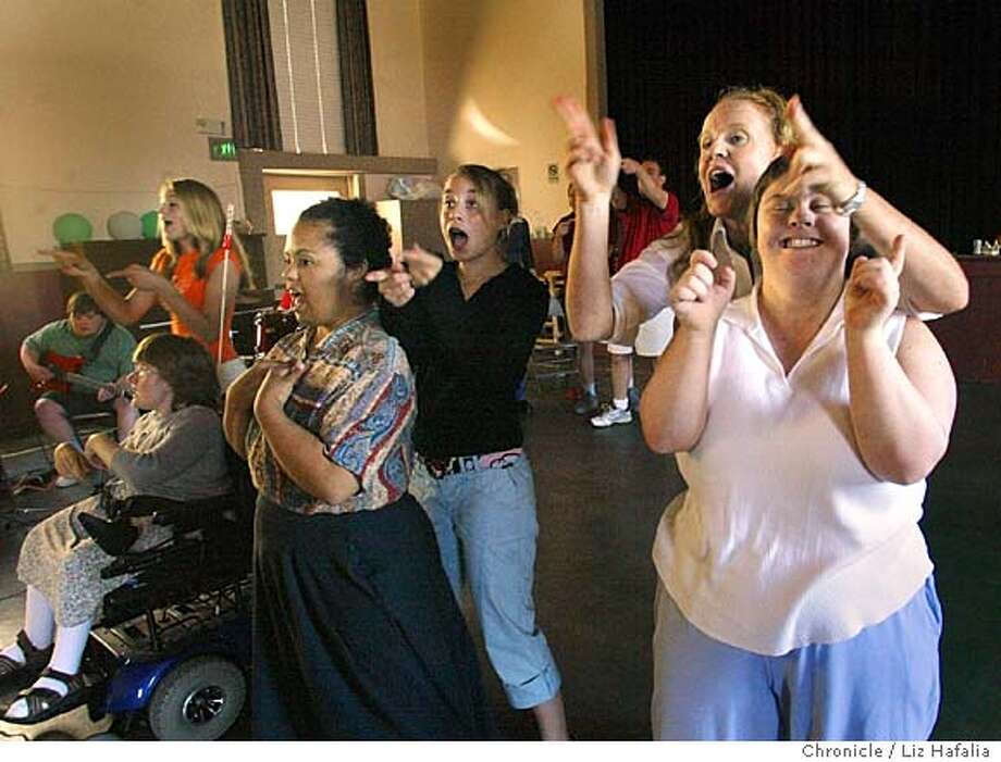 """At right is director Julia Macdougall (behind), with Cassie Puff, in the middle is Dylan Kaufman-Obstler (back) with Nonie Hall, and at left is Mikayla McVey (back) with Leila Massey (wheelchair). Alchemia Theater, a performing arts and vocational program for developmentally disabled adults, is doing a show called """"Wabisabi"""", meaning """"perfectly imperfect"""". Shot on 6/1/04 in Petaluma. LIZ HAFALIA / The Chronicle Photo: LIZ HAFALIA"""