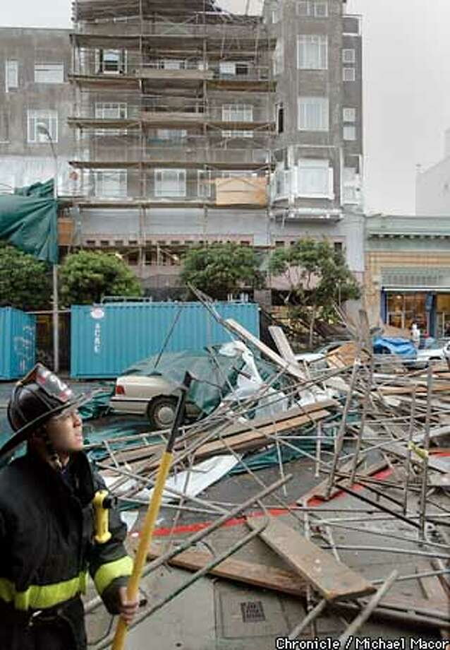 A seven story tall section of scaffolding ripped away from a building under construction and fell across Polk St., as a major storm passed through San Francisco today. The scaffolding fell onto three cars including the one in the center which was being driven at the time. The other two were parked. Between Washington and Jackson Sts. by Michael Macor/The Chronicle Photo: MICHAEL MACOR
