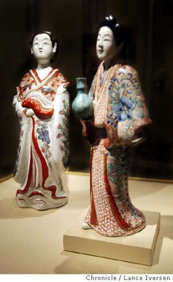 GEISHA053_LI.JPG event on 6/22/04 in SAN FRANCISCO The San Francisco Asian Art Museum will unveil a new exhibit this weekend titled . The exhibit looks at the life of a through art, music and clothing. A pair of porcelain dolls are on display dating back to 1650 to 1800. By Lance Iversen/San Francisco Chronicle Photo: Lance Iversen