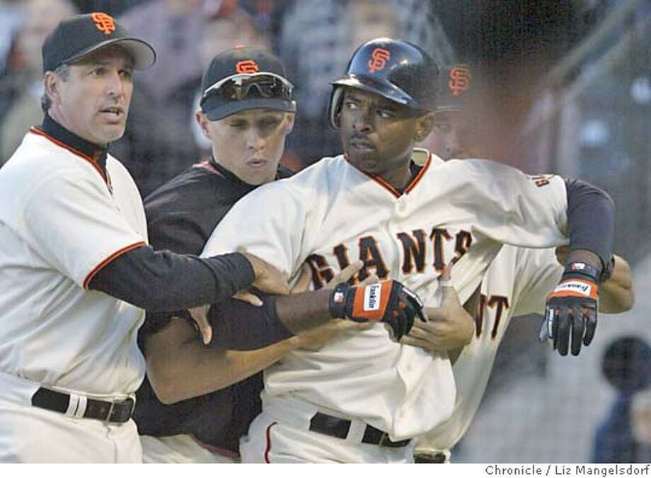 46FB0211.JPG Event on 6/24/04 in San Francisco.  Giant Michael Tucker is is held back teammates in the bottom of the 8th inning after he is almost hit by a pitch throw by Eric Gagne. Both Gagne and Tucker were thrown out of the game.  Giants beat the LA Dodgers to sweep the Dodgers in four games at SBC Park.  Liz Mangelsdorf / The Chronicle Photo: Liz Mangelsdorf