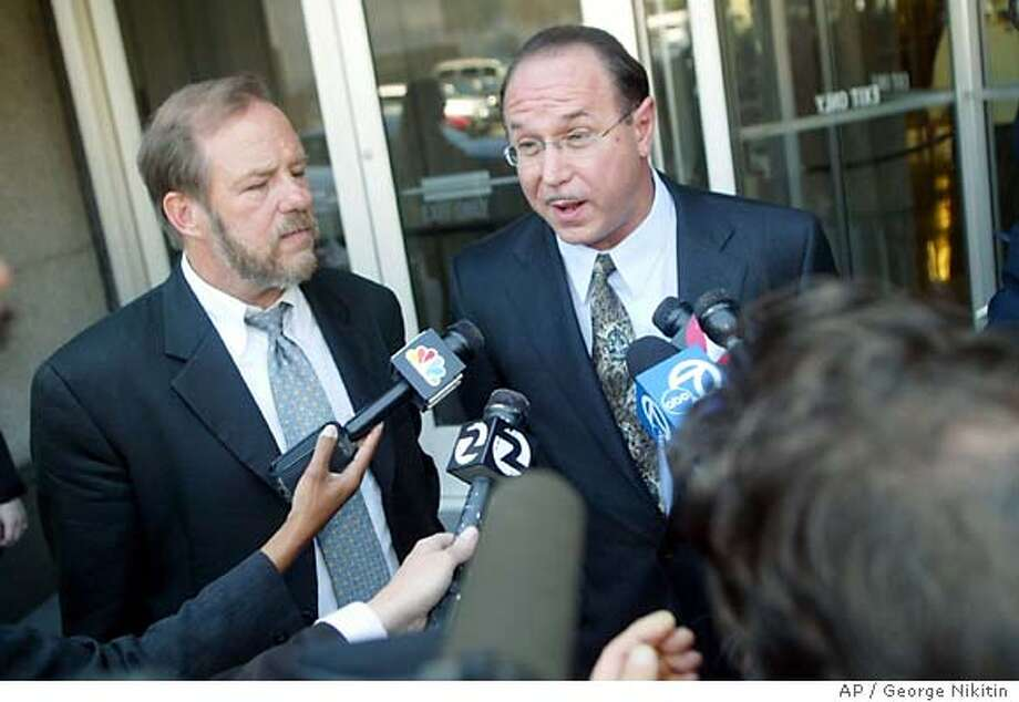 Victor Conte, right, Bay Area Laboratory Co-Operative's founder and one of the four people accused of illegally distributing steroids, talks with reporters outside the federal courthouse with his lawyer Robert Holley, left, in San Francisco on Friday, June 25, 2004. A judge on Friday ordered federal prosecutors to investigate whether the government leaked to the media grand jury transcripts in which sprinter Tim Montgomery testified he used performance-enhancing drugs. (AP Photo/George Nikitin) Photo: GEORGE NIKITIN