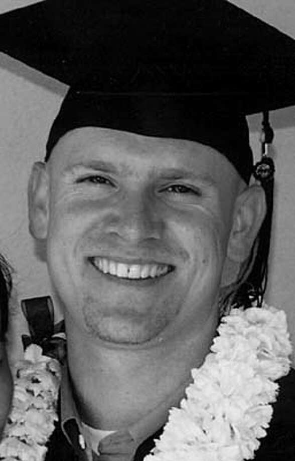 Nyima Sorensen, 26 from Berkeley, murdered in Oakland  outside a bar on College Ave.  Photo taken at his UC Berkeley graduation last year. DO NOT USE GIRL'S HANDOUT FROM FAMILY.