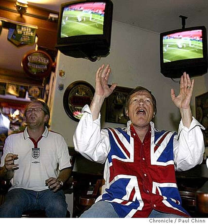 East Bay soccer fans Peter Molloy (right) and Peter Hetherington (left) react to a near goal by England as they watch the England vs. Switzerland European Cup match at The Englander pub in San Leandro on 6/17/04. PAUL CHINN/The Chronicle Photo: PAUL CHINN