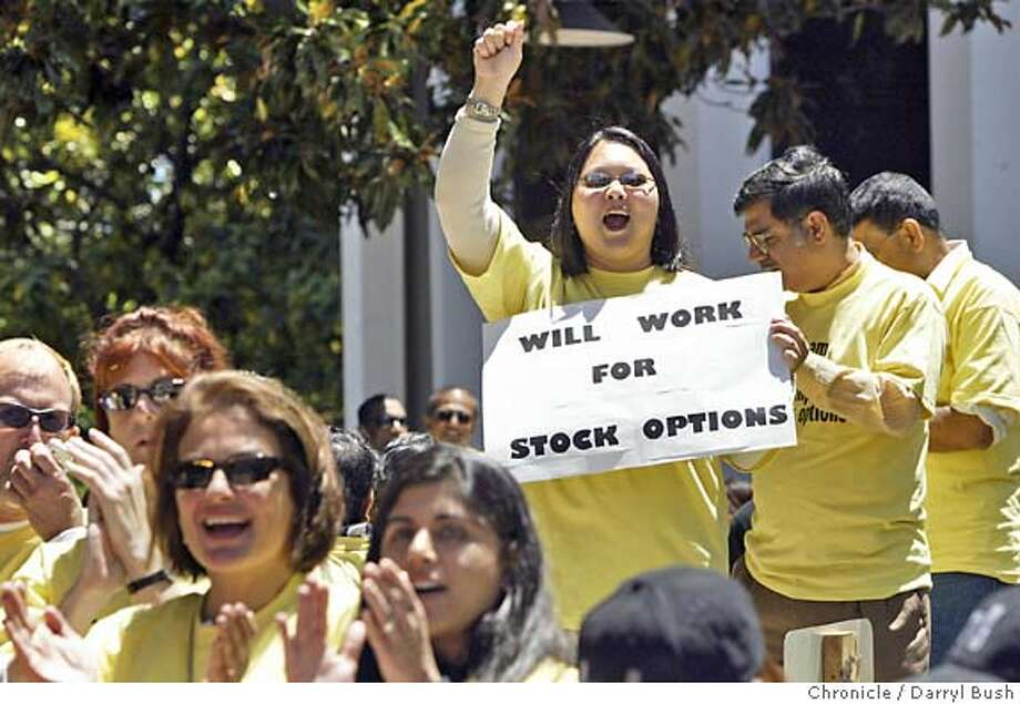 "Debbie Tsoi-A-Sue who manages the stock administration department at Sun Microsystems in Santa Clara, holds a sign that reads, ""Will Work For Stock Options,"" as she cheers at a rally of tech workers at Palo Alto City Hall to protest the FASB possible actions to set accounting rules that would force companies to make stock options an expense.  Event on 6/24/04 in Palo Alto.  Darryl Bush / Chronicle Photo: Darryl Bush"