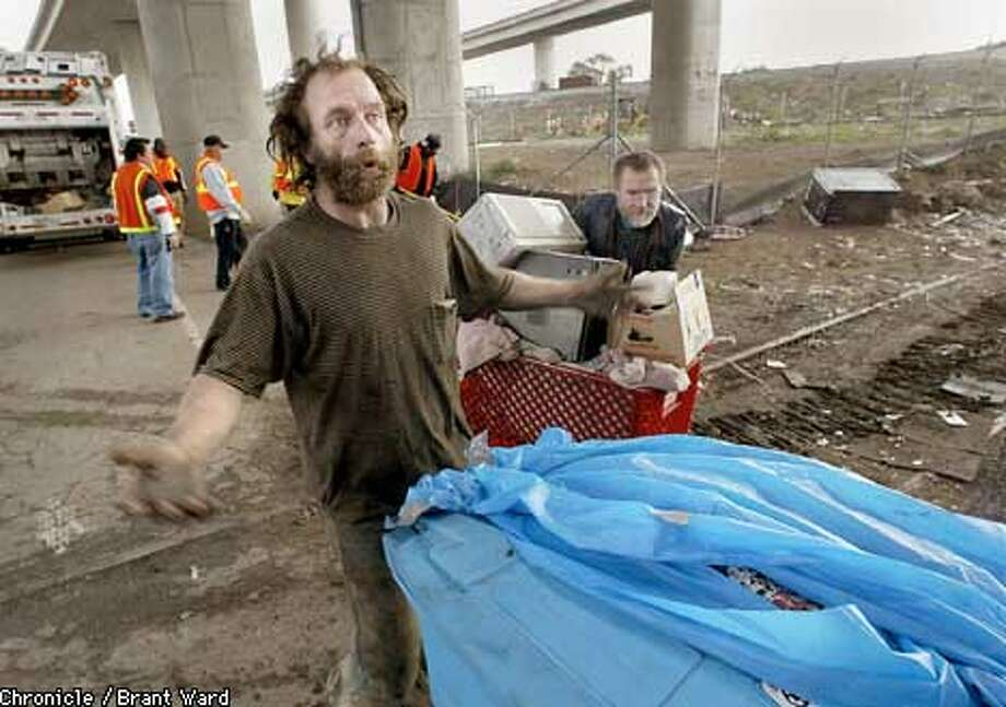 Frank Ryan, left, was rousted from his encampment near Evans and Selby in San Francisco Wednesday morning. He and other homeless who lived in the popular encampment will have trouble finding another place to sleep tonight. By Brant Ward/Chronicle Photo: BRANT WARD