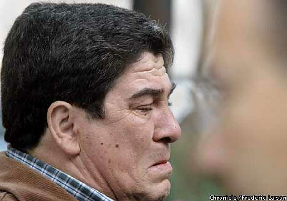 STAYNER4-C-13DEC02-MT-FRL: Family member Jose Pepe Pelosso (left) (father of Silvina) breaks down in tears outside the San Jose Superior Court house after hearing the sentencings of death for Yosemite murderer Cary Stayner. Right is Jens Sund husband and father of Juli and Carole. Chronicle photo by Frederic Larson (RAW Photo: FREDERIC LARSON