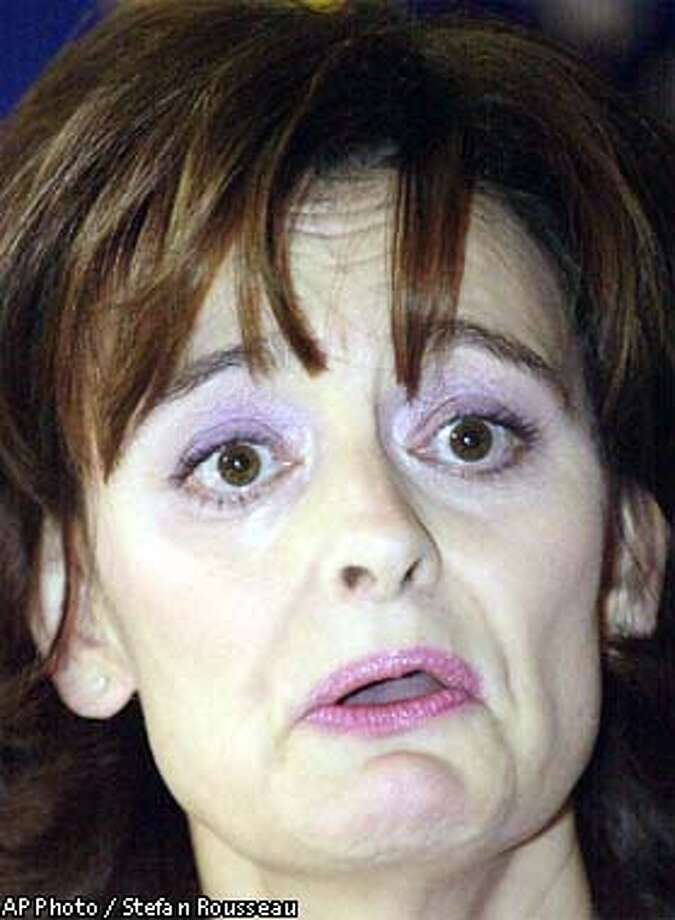 Cherie Blair, wife of British Prime Minister Tony Blair, makes a statement to the press in London, Tuesday Dec. 10, 2002, during which she choked back tears. Blair confronted the controversy surrounding convicted Australian fraudster Peter Foster's role in helping her close a $790,000 property deal. (AP Photo/Stefan Rousseau, Pool) Photo: STEFAN ROUSSEAU