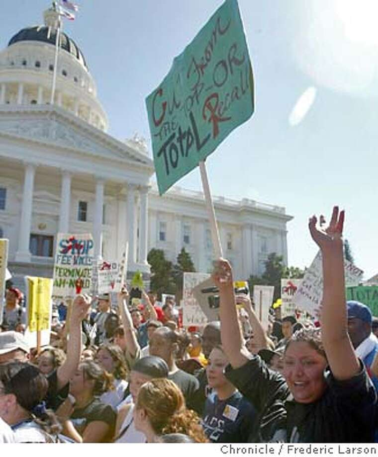 ; Maria Belen Morillo (sign far right) of Gilroy was one of thousands of public school students, faculty and staff rally at the state Capitol today. They say they're concerned about steep tuition hikes and overcrowding at the state's 109 community colleges. The California Community Colleges Chancellor's office says at least 175-thousand students were turned away because of budget cuts last year. About one-point-six million students are currently enrolled in the state's community colleges. Governor Arnold Schwarzenegger has proposed raising community college fees as much as 44 percent. But he's also proposed a funding increase for community colleges of about 100 (m)million dollars. That would restore a portion of recent cuts. City:� 3/15/04, in Sacramento, CA. Frederic Larson/The Chronicle; Photo: Frederic Larson