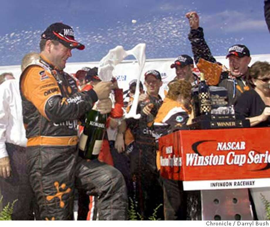 nascar112_db.jpg  �  Robby Gordon, left, celebrates with champagne after winning the NASCAR Winston Cup Series, Dodge/Save Mart 350 at Infineon Raceway. 6/22/03 in Sonoma.  DARRYL BUSH / The Chronicle MANDATORY CREDIT FOR PHOTOG AND SF CHRONICLE/ -MAGS OUT Photo: DARRYL BUSH
