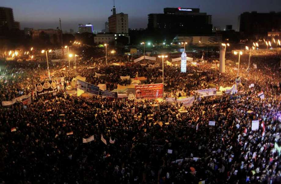 Protesters fill Tahrir Square after sundown in Cairo, Egypt, Wednesday, Jan. 25, 2012. Tens of thousands of Egyptians rallied Wednesday to mark the first anniversary of the country's 2011 uprising, with liberals and Islamists gathering on different sides of Cairo's Tahrir Square in a reflection of the deep political divides that emerged in the year since the downfall of longtime leader Hosni Mubarak.(AP Photo/Nasser Nasser) Photo: Nasser Nasser / AP