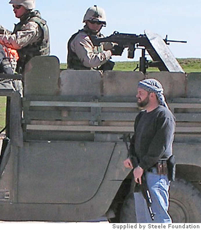 steele_1.jpg  Unlike U.S. soldiers, Steele Foundation security agents in Iraq wear civilian clothes, including kaffiyeh headscarves.  Photo supplied by Steele Foundation Photo: Handout