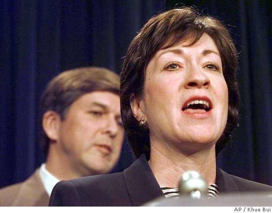 Sen. Susan Collins, R-Maine, right, accompanied by Sen. Gordon Smith, R-Ore., meets reporters on Capitol Hill Wednesday, Jan. 27, 1999, after the Republican-led Senate authorized House prosecutors to question Monica Lewinsky and two other witnesses in the impeachment trial after refusing to dismiss perjury and obstruction of justice charges against President Clinton. (AP Photo/Khue Bui) ELECTRONIC IMAGE Politics#MainNews#Chronicle#11/4/2003#ALL#5star#A14# Photo: KHUE BUI
