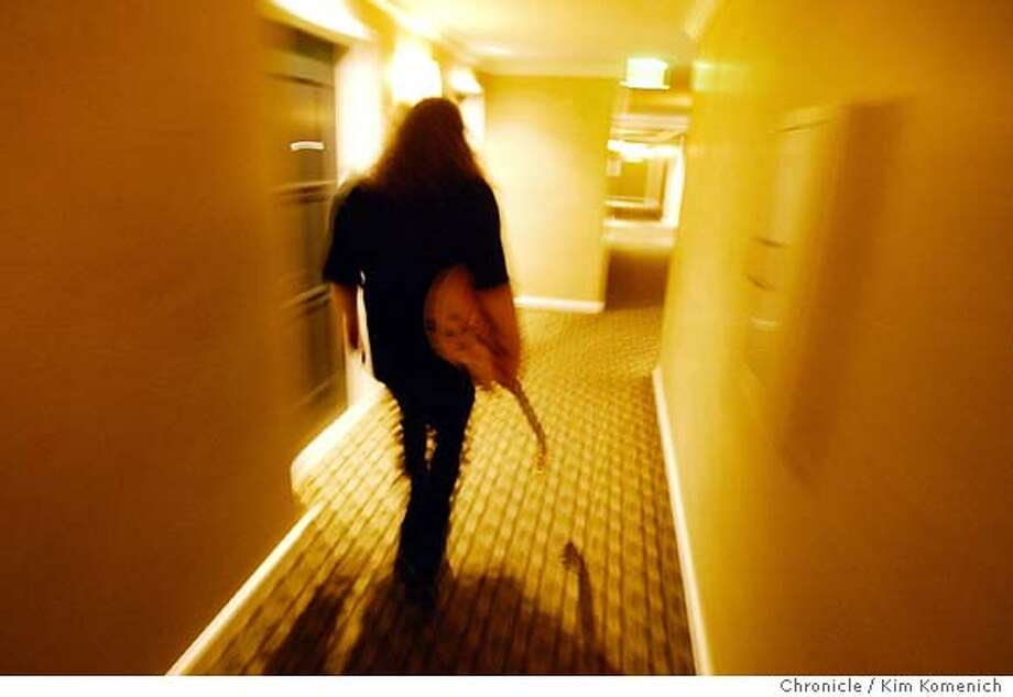 Haynes returns to his room after a photo shoot for Guitar Player Magazine. Warren Haynes is making his second tour this summer as Jerry Garcia's replacement in the Dead. We photograph him in his hotel room with his acoustic guitar in anticipation of his upcoming Fillmore acoustic show.  Photo by Kim Komenich in San Francisco. Photo: Kim Komenich