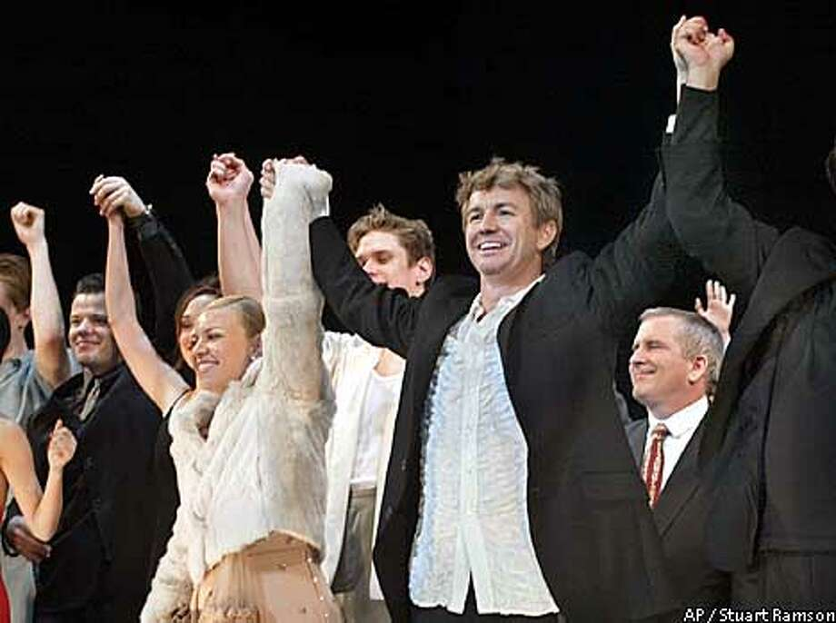 Director Baz Luhrmann and his designer wife Catherine Martin, center, on stage during the curtain call at the conclusion of the Broadway debut of Luhrmann's production of Puccini's 'La Boheme', in New York, December 8, 2002. (AP Photo/ Stuart Ramson) Photo: STUART RAMSON