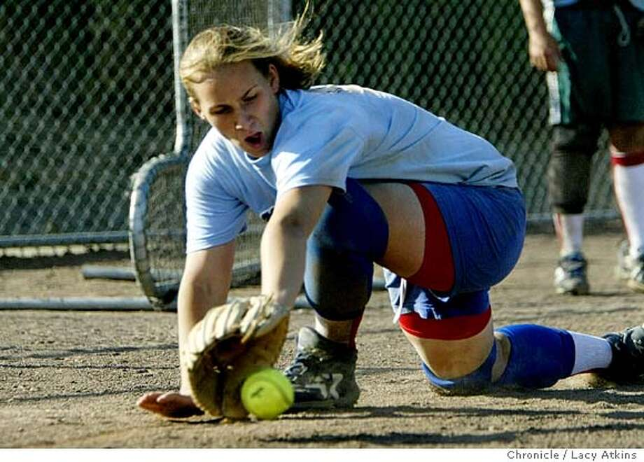 Whitney Shaw, of the Afterrshock softball team, dives for a grounder during practice, Thursday June 17, 2004, in San Rafael. The young girl softball team ages 14 and under practice at the Benard Hoffman field in San Rafael, Thursday June 17, 2004. The girls come from various towns in Marin, Sonoma and Napa Counties.  LACY ATKINS / The Chronicle Photo: LACY ATKINS