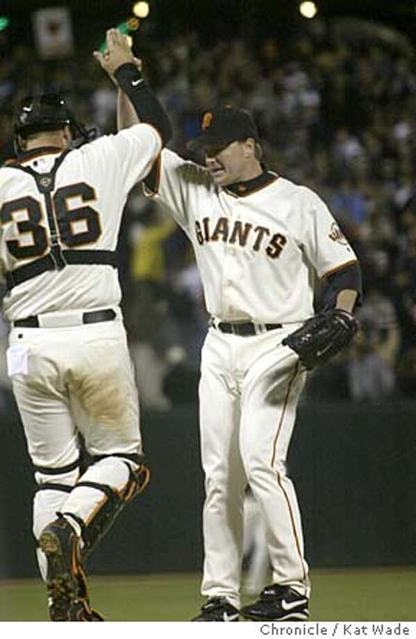The San Francisco Giant's pitcher Matt Herges (LEFT) slaps hands with catcherA.J. Pierzynski after throwing the final out of the game in the top of the 9th inning during the game against the Los Angeles Dodger's in San Francisco Wednesday night on 6/23/04 at Pac Bell Park. Kat Wade/The Chronicle Photo: Kat Wade
