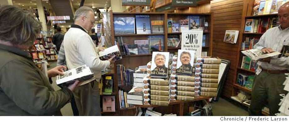 ; Customers at Stacey Bookstore at 581 Market Street in San Francisco huddle around former President Clinton new tell all publication of his life released today. 6/22/04  San Francisco Chronicle Frederic Larson Photo: Frederic Larson