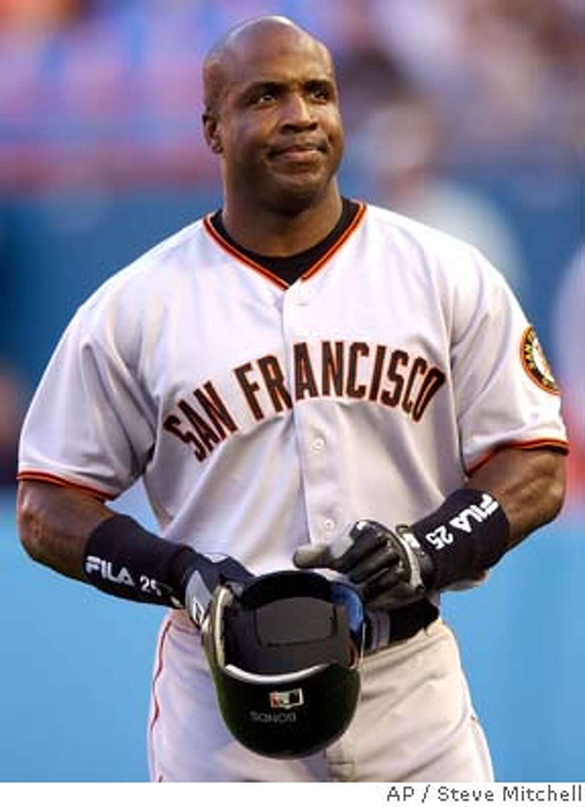 San Francico Giants Barry Bonds react after flying out during the first inning against the Florida Marlins Thursday, May 8, 2003, at Pro Player Stadium in Miami. (AP Photo/Steve Mitchell)