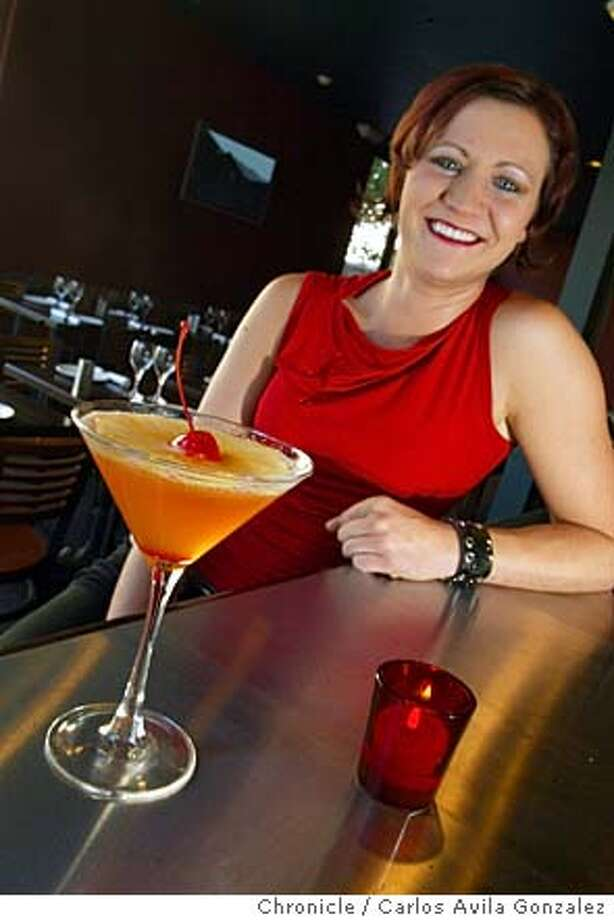 Bartender Sarah Duncan with her finished Basque Martini cocktail, at Iluna Basque in San Francisco, Ca., on Wednesday, May 19. 2004.  Photo taken on 01/20/04 in Pinole, Ca. Photo By Carlos Avila Gonzalez / The San Francisco Chronicle Photo: Carlos Avila Gonzalez