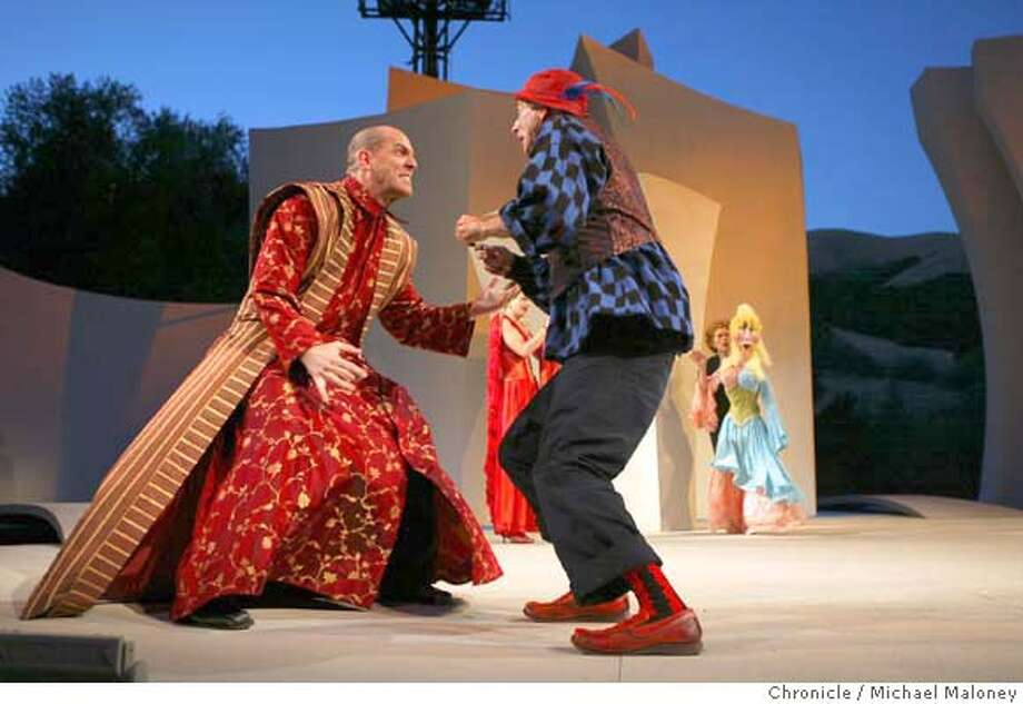 "Andy Murray (left) and Ron Campbell fight. In background is Stacy Ross (red dress) and Joan Mankin with puppet.  Photo call for California Shakespeare Theater's opening show, ""The Comedy of Errors"" at Bruns Amphitheater in Orinda. The production is a radical new look at the old play in terms of design and use of puppets. Ron Campbell, Andy Murray, Joan Mankin and Stacy Ross are principal actors. Photo by Michael Maloney / San Francisco Chronicle Photo: Michael Maloney"