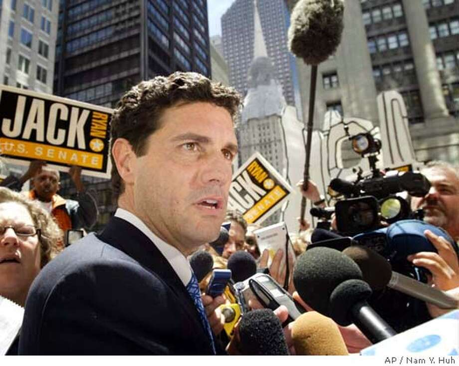 "Republican U.S. Senate hopeful Jack Ryan meets with reporters outside the Thompson Center, Tuesday, June 22, 2004, in Chicago, a day after portions of documents related to his divorce with actress Jeri Lynn Ryan were released. Jack Ryan began publicly trying to salvage his candidacy Tuesday, defending his character and calling the uproar over allegations that he urged his then-wife to have sex in front of others ""a new low for politics."" (AP Photo/Nam Y. Huh) Photo: NAM Y HUH"