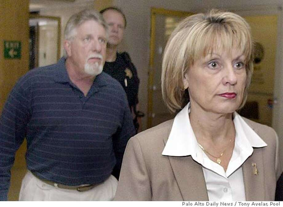 Sharon Rocha and Ron Grantski, left, Laci Peterson's mother and stepfather, enter the San Mateo County Courthouse Tuesday, June 22, 2004, for the Scott Peterson trial in Redwood City, Calif. Peterson is charged with the murders of his wife Laci Peterson and their unborn son (AP/ Palo Alto Daily News, Tony Avelar, pool)