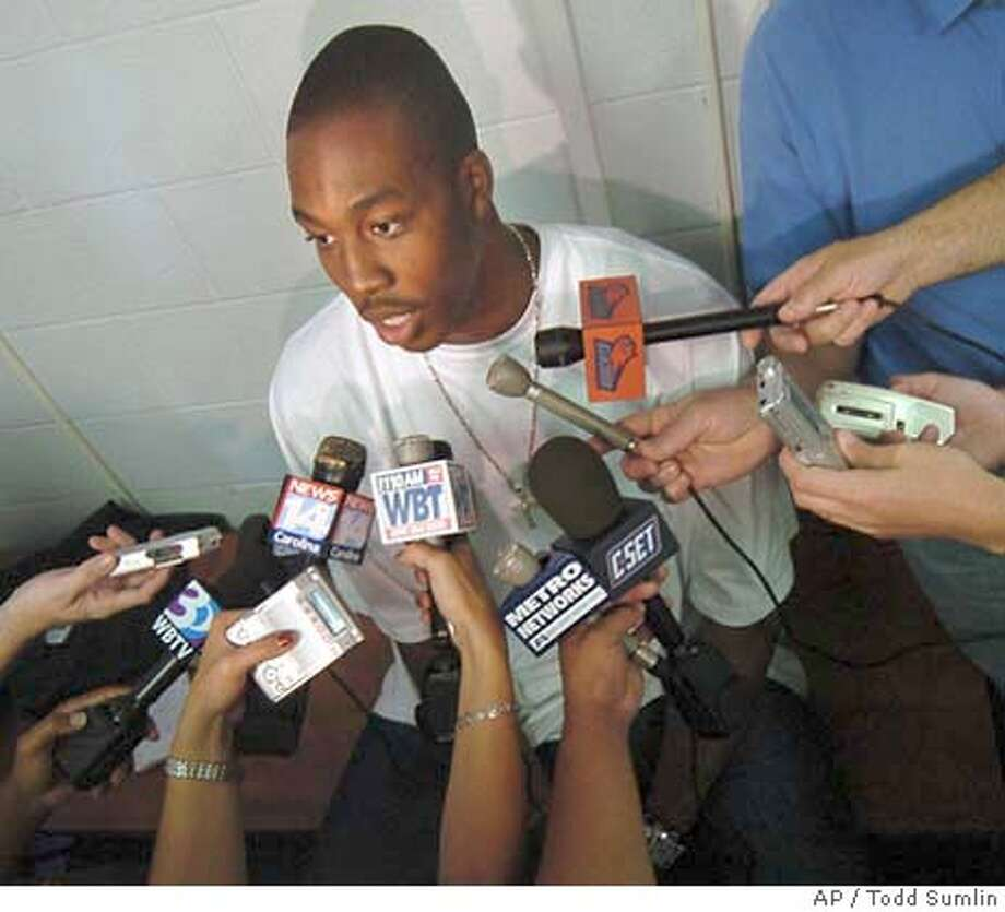 Dwight Howard talks to reporters and photographers at the Charlotte Bobcats training facility in Fort Mill, S.C. Tuesday, June 22, 2004. Howard visited with Bobcats staff prior to Thursday's NBA draft. (AP Photo/The Charlotte Observer,Todd Sumlin) Photo: TODD SUMLIN