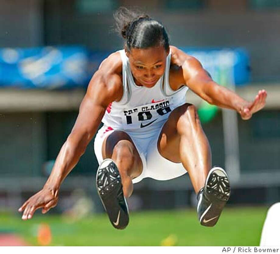 Marion Jones jumps in the long jump at Prefontaine Classic Track and Field Meet Saturday, June 19, 2004, in Eugene, Ore. Jones won the event with a jump of 22.-09.00 . (AP Photo/Rick Bowmer) Ran on: 06-20-2004  Marion Jones won the long jump with a leap of 22 feet, 9 inches, but placed fifth in the 100. Ran on: 06-20-2004 Photo: RICK BOWMER