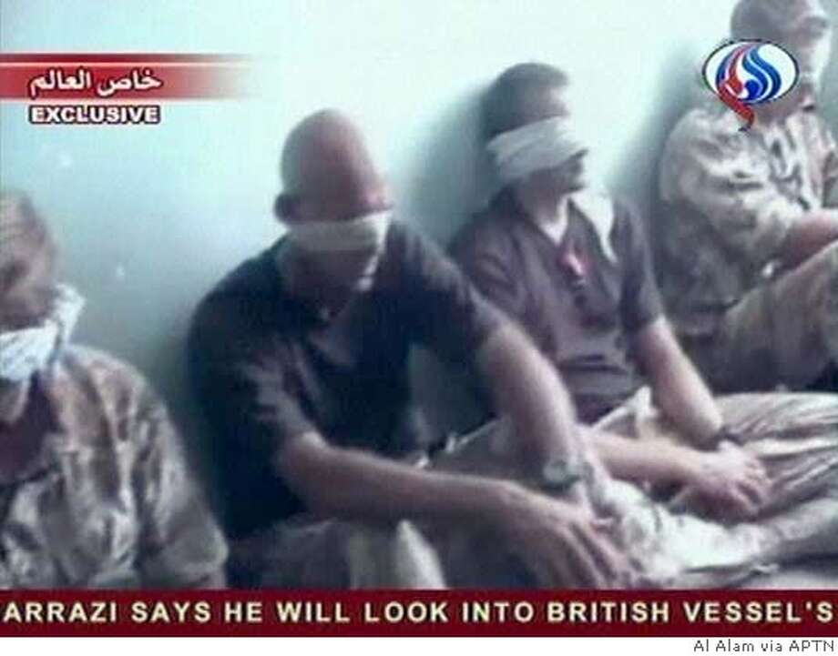 British sailors sit blindfolded on a floor at an undisclosed location in Iran after they were arrested and their three small boats seized on the Shatt- al Arab waterway which runs along part of the Iran-Iraq border in this image from Iranian Al-Alam television broadcast Tuesday June 22, 2004. (AP Photo/Al Alam via APTN) ** IMAGE FROMTV TV OUT IRAN OUT ** IMAGE FROM TV TV OUT IRAN OUT