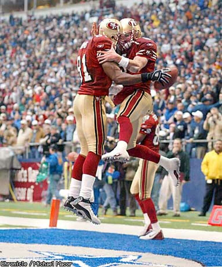 49ers Terrell Owens , left celebrates his winning TD catch upon the Dallas Star in the endzone with quarterback Jeff Garcia, both get airborn with excitment. San Francsico Forty Niners v. Dallas Cowboys at Texas Stadium, Irving, Texas, Dec. 8, 2002. by Michael Macor/The Chronicle Photo: MICHAEL MACOR