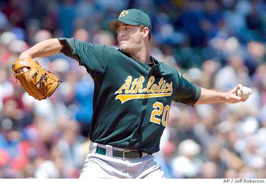Oakland Athletics starting pitcher Mark Mulder throws during the first inning against the Chicago Cubs Saturday, June 19, 2004 in Chicago. (AP Photo/Jeff Roberson) Photo: JEFF ROBERSON