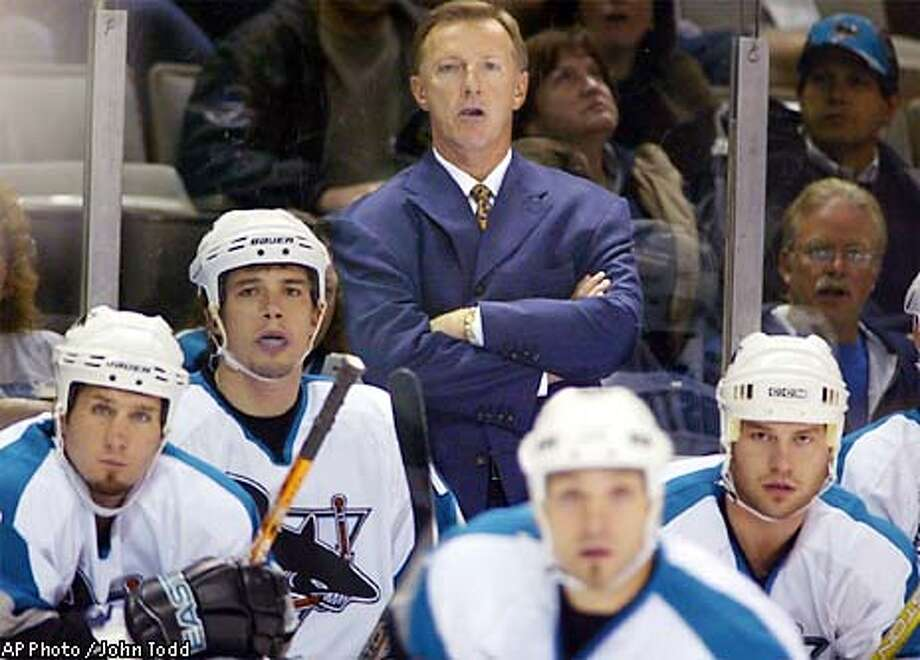 The San Jose Sharks' new coach, Ron Wilson, center, watches the game against the Columbus Blue Jackets with players, from left, Bryan Marchment, Todd Harvey, Scott Thorton and Mark Smith during the first period in San Jose, Calif., Friday, Dec. 6, 2002. (AP Photo/John Todd) Photo: JOHN TODD