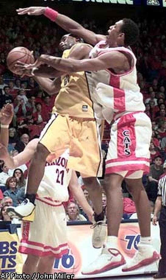 California's Brian Wethers (left) goes for two under the basket despite the attempted block of his shot by Arizona's Channing Frye (right) in the second half at McKale Center in Tucson, Arizona on Thursday, Mar. 2, 2002. final score Arizona 99 - California 53. (AP Photo/John Miller) Photo: JOHN MILLER