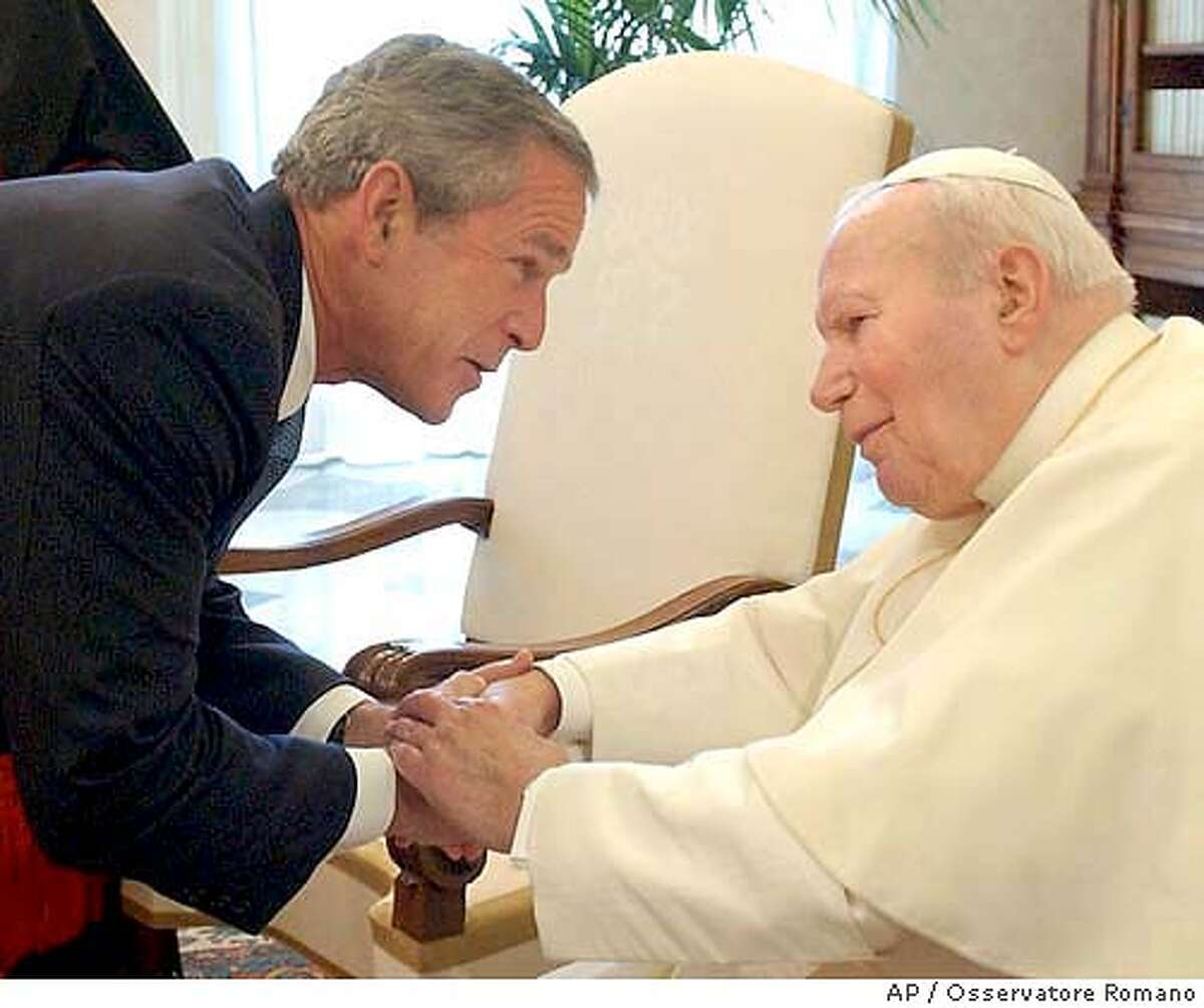 ** TRANSMISSION TO PROVIDE ALTERNATE CROP ** US President George Bush is greeted by Pope John Paul II upon their meeting in his private library at the Vatican, Friday, June 4, 2004. Bush is in Italy for 36 hours to mark the 60th anniversary of Rome's liberation and meet the Pope and Italian leaders. (AP Photo/Osservatore Romano, HO) Pope John Paul II greets President Bush in the pope's private library at the Vatican. Pope John Paul II greets President Bush in the pope's private library at the Vatican. He praised Bush's leadership against AIDS in Africa. TRANSMISSION TO PROVIDE ALTERNATE CROP