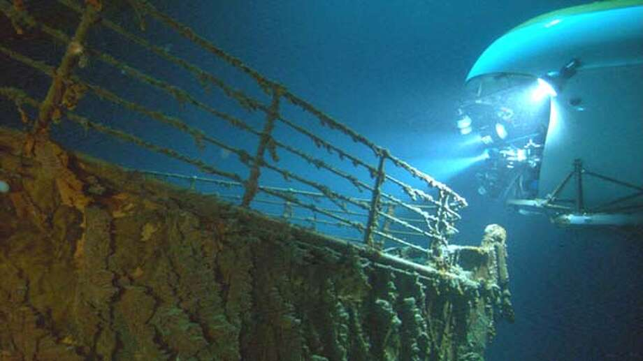 "HANDOUT:  A MIR submersible (right) observing the bow of the Titanic wreck. Walt Disney Pictures presents ""Ghosts of the Abyss "" in association with Walden Media, an Earthship Production, produced and directed by James Cameron.  For GHOSTS11 Ran on: 06-19-2004  Observers in a submersible watercraft view the bow of the Titanic wreck in the Atlantic Ocean. Photo: HO"