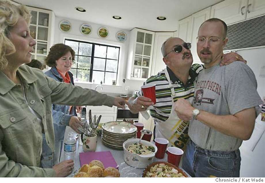 Redwood City neighbors (from left) Donna Bingham, Tricia Cate, Steve Bingham and Steve Cate gather at a friend's house on McNulty Way for a barbecue. They represent a wide political spectrum. Chronicle photo by Kat Wade