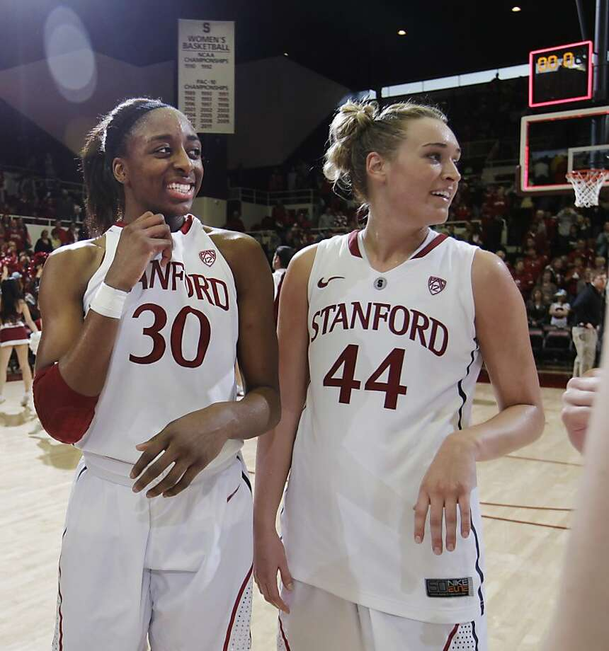 Stanford forward Nnemkadi Ogwumike (30) and forward Joslyn Tinkle (44) smile after their game against Washington in an NCAA college basketball game in Stanford, Calif., Saturday, Jan. 21, 2012. Stanford defeated Washington 65-47.  Ogwumike was game high scorer with 17 points. (AP Photo/Paul Sakuma) Photo: Paul Sakuma, Associated Press