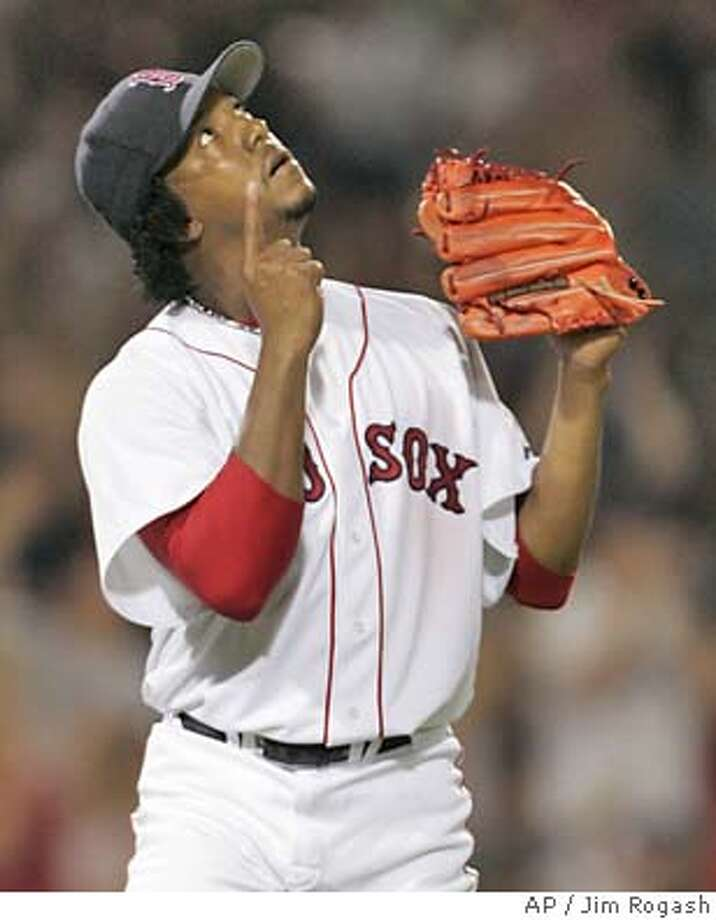 Boston Red Sox pitcher Pedro Martinez gestures skyward after finishing the eighth inning against the San Diego Padres at Fenway Park in Boston, Tuesday, June 8, 2004. Martinez and the Red Sox won 1-0. (AP Photo/Jim Rogash) Photo: Jim Rogash