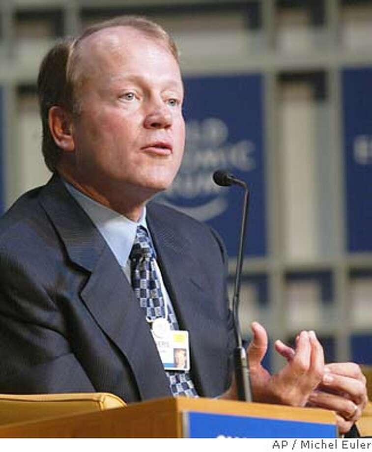 President of Cisco System, American John Chambers, gestures as he speaks during a panel at the World Economic Forum in Davos, Switzerland, Sunday Jan. 25, 2004.(AP Photo/Michel Euler) John Chambers, CEO of Cisco, has a cautious outlook. Cisco CEO John Chambers sees sales growth of 1 to 3 percent. Photo: MICHEL EULER