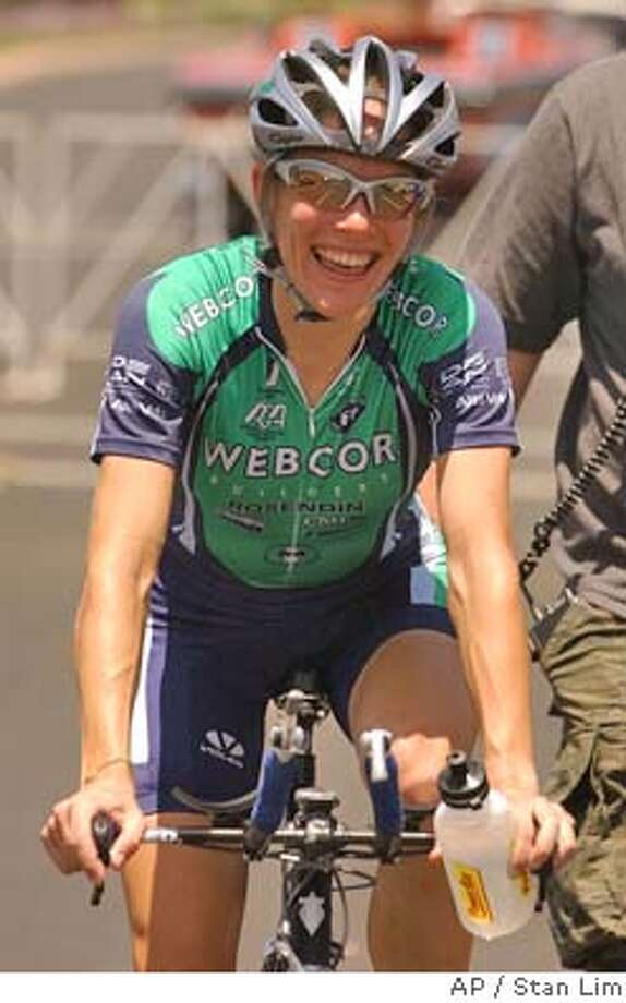Christine Thorburn, of team Webcor Builders, is all smiles after winning the womens 2004 United States Cycling Federation National Championship Individual Time Trial on Thursday, June 17, 2004 in Moreno Valley, Calif., and earns herself a spot on the USA Olympic Team.  (AP Photo/The Press-Enterprise,Stan Lim) **MANDATORY CREDIT** MAGS OUT. Photo: Stan Lim