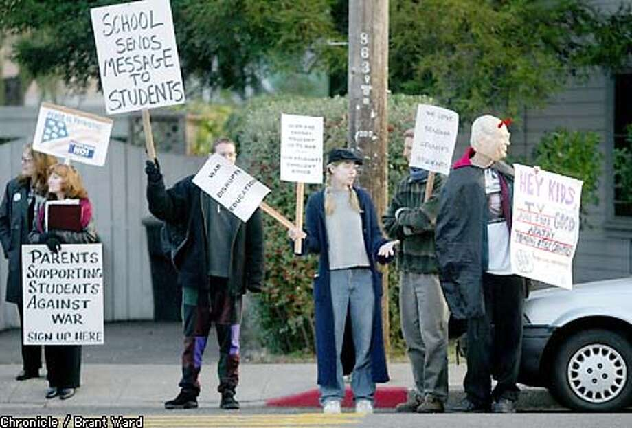 Outside Petaluma High School, parents, students and citizens protested the recent suspension of students for their stand on a possible war with Iraq Wednesday morning. The students walked out of classes and were suspended for a day. By Brant Ward/Chronicle Photo: BRANT WARD