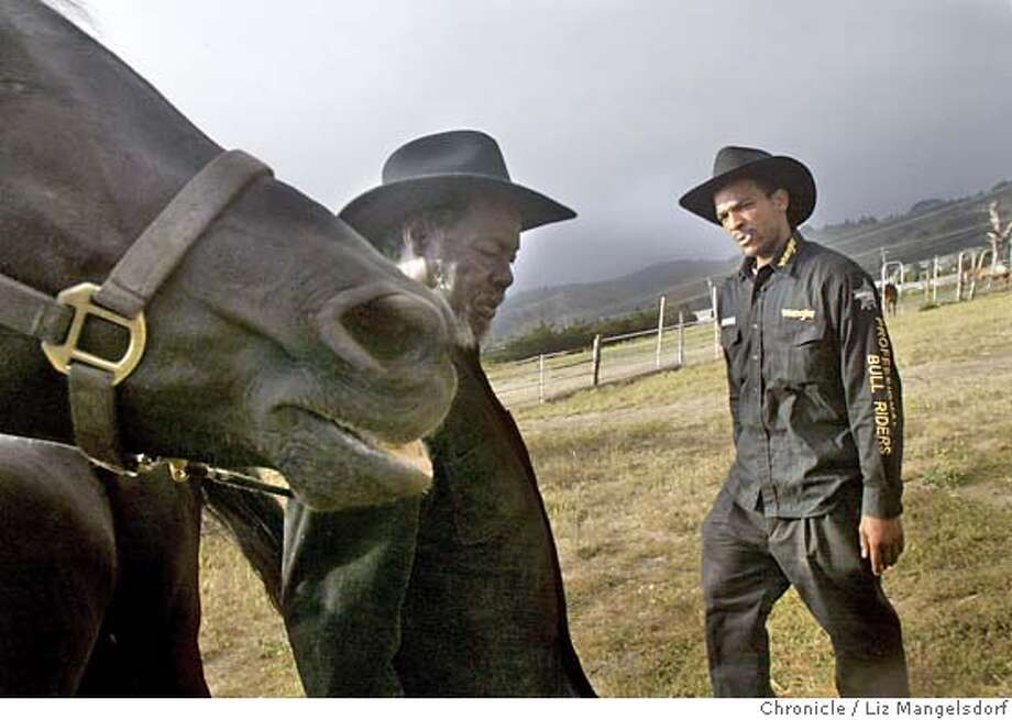 Event on 6/16/04 in San Francisco.  Gregory McDowell, right, watches as his uncle Richard Bougere leads a horse at the Friendly Acres Stables. Gregory Mcdowell, and other members of his family, with their horses at the Friendly Acres stable in Half Moon Bay, where they are preparing for the Juneteenth Parade.  Liz Mangelsdorf / The Chronicle Photo: Liz Mangelsdorf