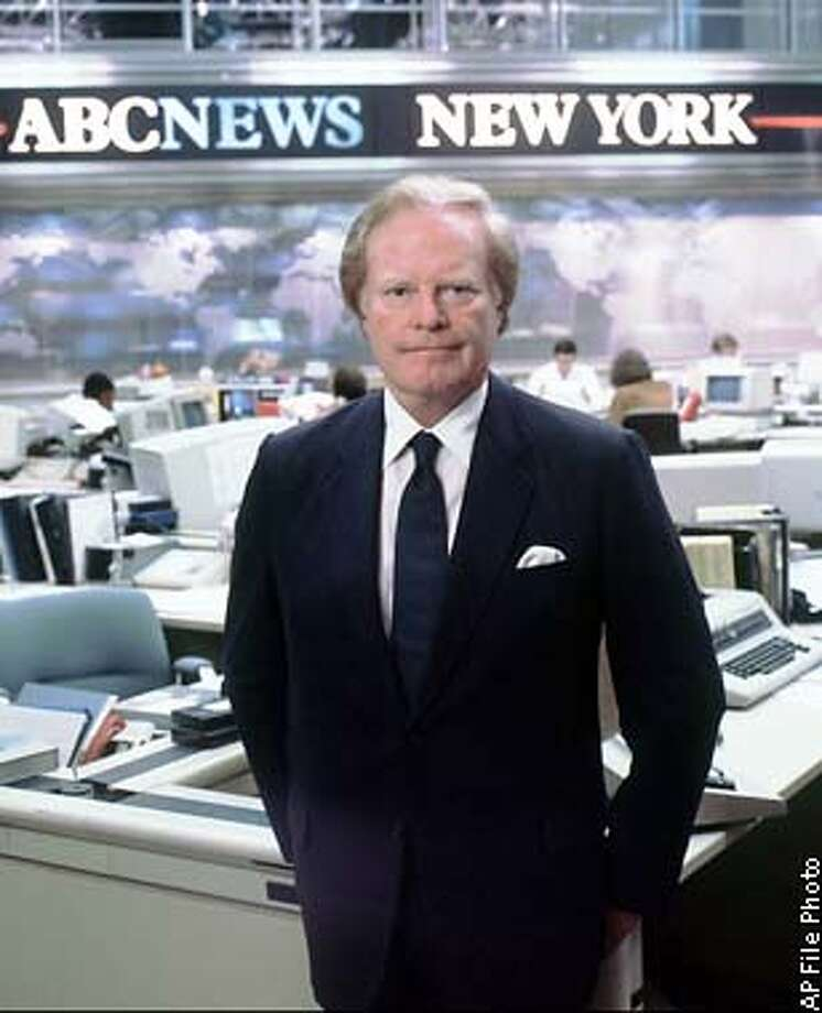 ** FILE ** Legendary television figure Roone Arledge is shown in this June 1977 file photo in New York. Arledge, a pioneering television executive at ABC News and Sports responsible for creating shows from ``Monday Night Football'' to ``Nightline,'' died Thursday, Dec. 5, 2002 at Memorial Sloan-Kettering Cancer Center in New York, an ABC News spokesman said. He was 71. (AP Photo/ Enrico Ferorelli, ABC) Photo: ENRICO FERORELLI