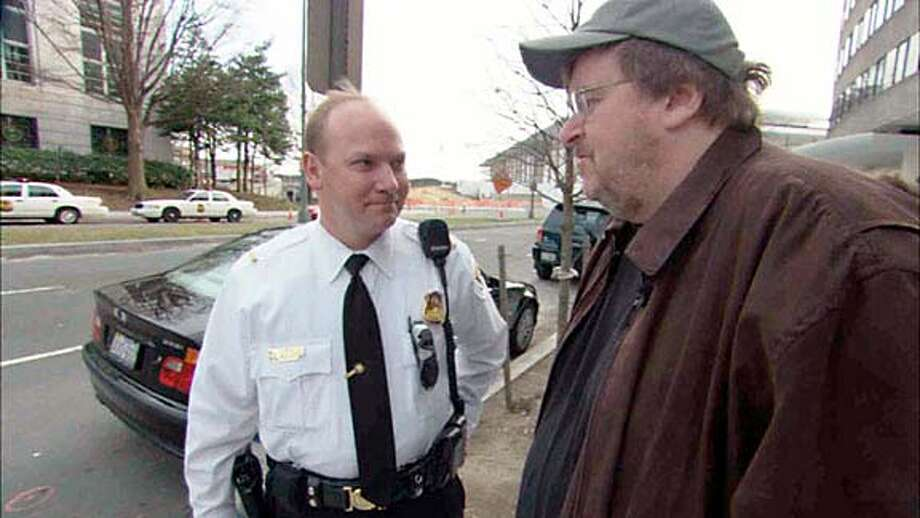 Fahrenheit 9/11 Michael Moore and police officer Handout