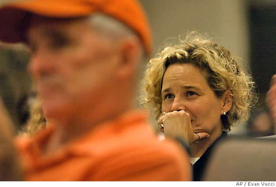 Kristen Breitweiser, right, who lost her husband Ron Breitweiser in the attacks on the World Trade Center, listens to testimony during the last public hearing of the Sept. 11 Commission on Thursday, June 17, 2004 in Washington. (AP Photo/Evan Vucci) Photo: EVAN VUCCI