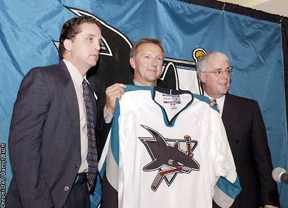 WILSONA-C-04NOV02-SP-DB Ron Wilson center, is joined by Sharks general manager, Dean Lombardi, left, and Sharks President and CEO Greg Jamison, right, at a press conference as Wilson is announced as the San Jose Sharks new head coach at San Jose. CHRONICLE PHOTO BY DARRYL BUSH Photo: Darryl Bush