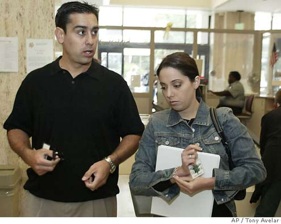 Brent Rocha, left, brother of Laci Peterson, and Amy Rocha, sister of Laci Peterson, arrives for the Scott Peterson trial in Redwood City, Calif., Thursday, June 3, 2004. Peterson is the Modesto, Calif., man who could face the death penalty if he's convicted of two counts of murder for the deaths of his wife, Laci Peterson, and their unborn child. (AP/Palo Alto Daily News, Tony Avelar, pool)