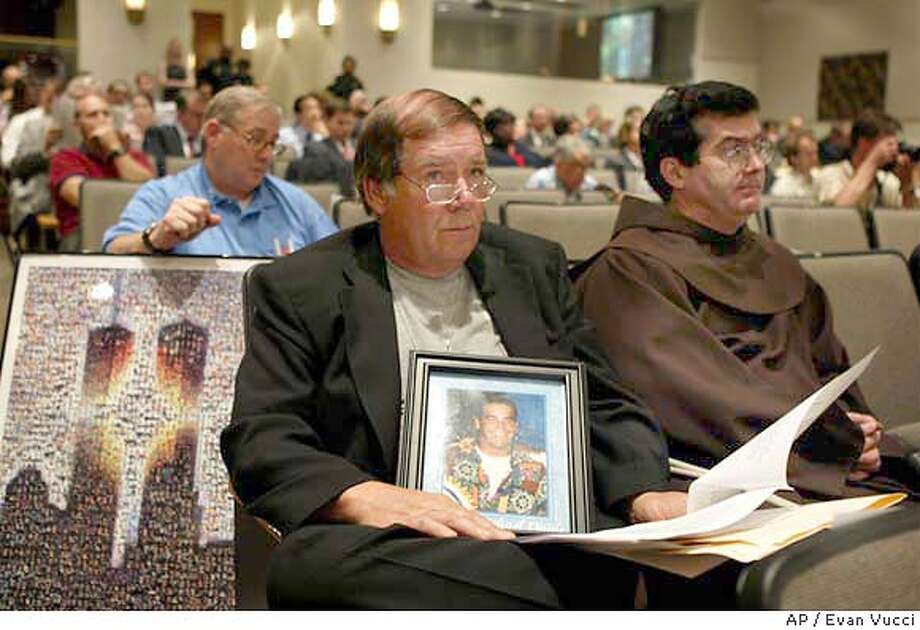 Bruce DeCell, left rear, Bill Doyle, center, and Father Brian Jordan, right, listen to the 9-11 Commission public hearing on Wednesday, June 16, 2004 in Washington. DeCell lost his son in law Mark Retrocelli in the North Tower of the World Trade Center, Doyle lost his son Joseph Doyle in the Nort Tower of the World Trade Center, and Jordan is a fellow friar of Father Michael Judge who was also killed in the Trade Center attack. (AP Photo/Evan Vucci) Photo: EVAN VUCCI